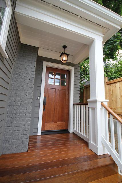 grey house; wooden porch / door