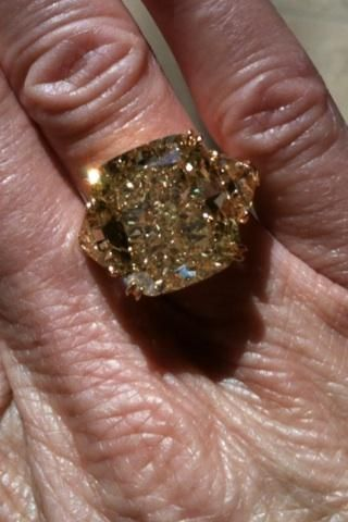 trying on a huge yellow cushion cut diamond ring with trillions at Harry Winston - a rare beauty