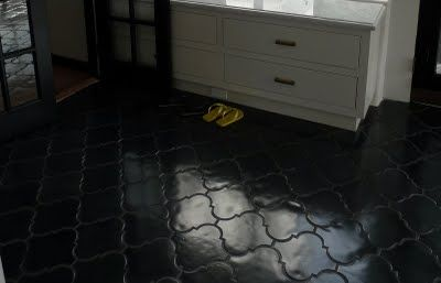 Glossy black floor: It is heavenly, I know.   Here is the info for all of you that asked!   I purchased the tiles from Mission Tile West in Pasadena.   It is called San Felipe in Jet Black (10 1/2 X 10 1/2 smooth)   ask for Melissa Sammartano (626)799-4595   they are heavy cement pavers , I chose a dark gray grout, and then I   sealed the hell out of them with really high gloss.   wallah!