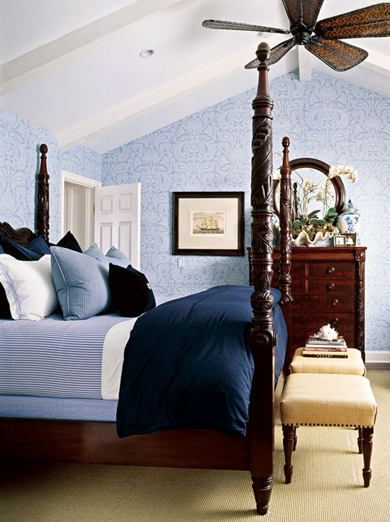 Sweet paisley covers this gorgeous blue master bedroom - Traditional Home®