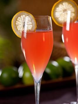 Romance Caribeno Cocktail   1/2 oz. Malibu rum   1 oz. Cointreau, or Grand Marnier   1/2 oz. fresh lime juice   1/2 oz. fresh lemon juice   3 oz. chilled lemon-lime soda   Dash of grenadine, for color   Lemon wheel