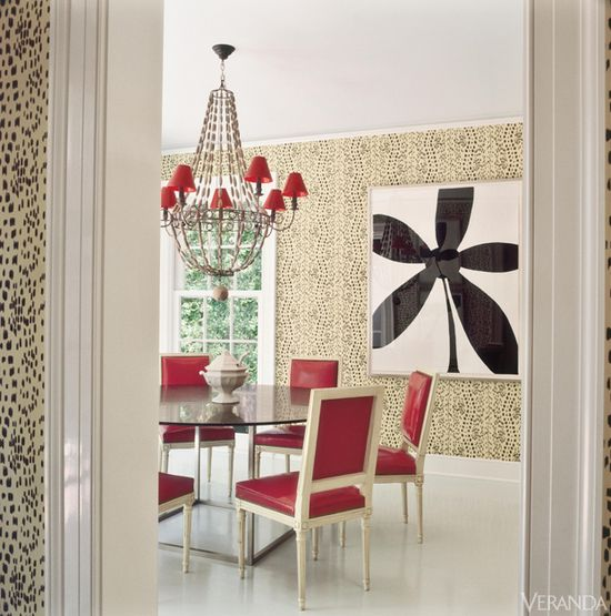 """Miles Redd ~ """"The clients shared my affinity for glamorous but cozy rooms,"""" says Redd. """"They wanted comfortable sophistication and edgy chic, with virtuosity in the details.""""  Red pops against graphic black and white. Table, Lucca & Co. Vintage chairs, Todd Alexander Romano, in Brentano faux leather. Chandelier, Treillage. Wallcovering, Brunschwig & Fils."""