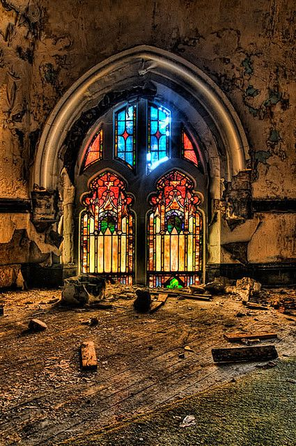 stained glass window in an abandoned church