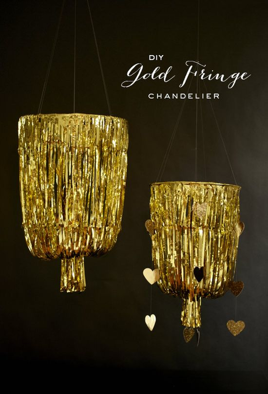 DIY gold fringe chandelier via 100 Layer Cake