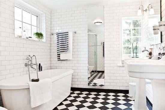 white tiled bathrooms
