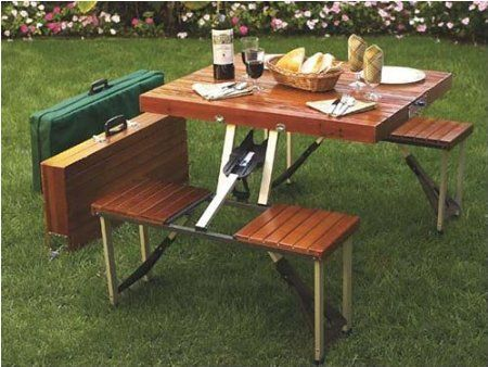 Suitcase Picnic Table.  Set up a picnic table anywhere you want with this portable suit case picnic table. At only twenty-two pounds this picnic table suit case makes an ideal portable eating station while at the beach or at a tail gate party. All you need is to unfold and enjoy your picnic.  Available at ThisIsWhyImBroke.com