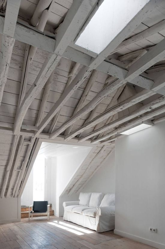 Love the grey rafters/logs! Baixa House / Jose Adriao Arquitectos