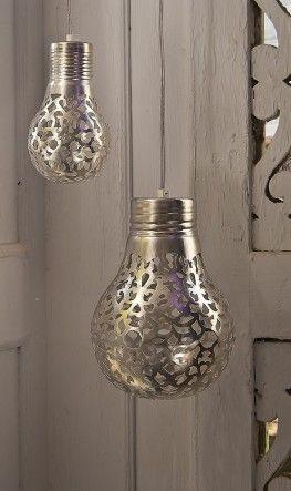Spray paint through lace on bulbs