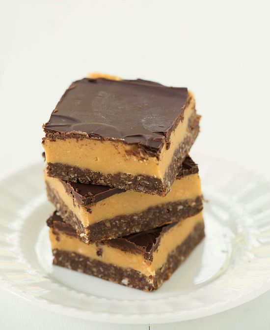 Peanut Butter Nanaimo Bars by Brown Eyed Baker ~ Tradition meets peanut butter for an exceptional new treat! #bar #chocolate #peanutbutter #dessert #snack #recipe