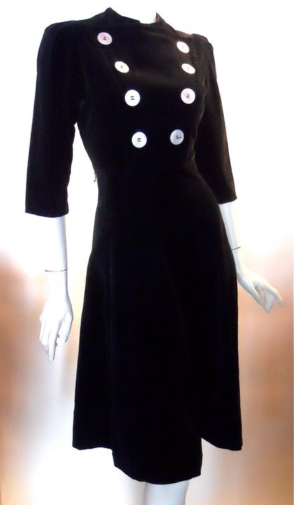 Black velveteen early 40s dress with military inspired mother of peark buttons in 2 rows down bodice, fit n' flare skirt.