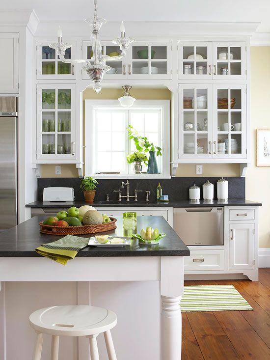 Beautiful glass front cabinet doors in this crisp and clean kitchen design.