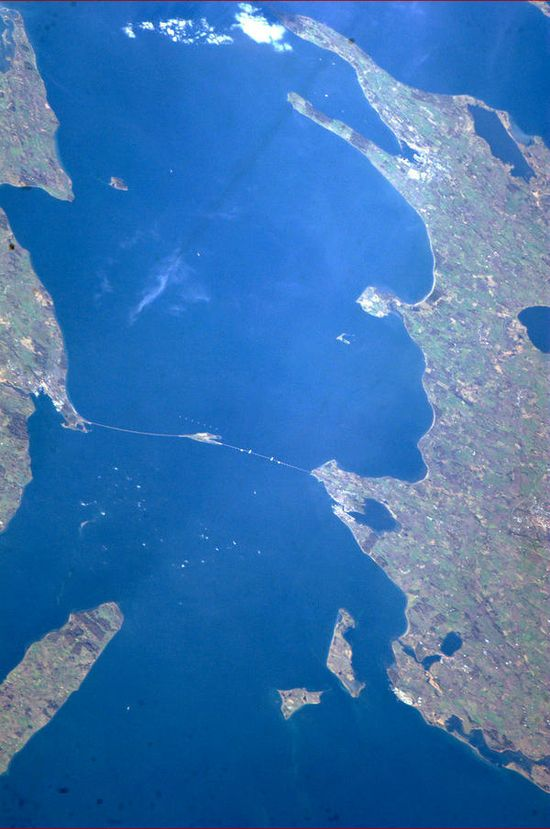 """Great Belt Bridge, Denmark, connecting Zealand and Fyn. Straight lines stand out against nature when viewed from space."""
