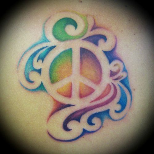 I don't care for the peace sign, but do like the idea of the tattoo using the negative space and no outline