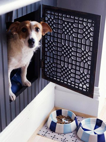 dog crate made from kitchen cabinet and floor grate