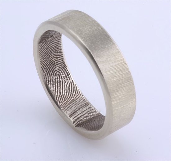 my fingerprint on his wedding band... i WILL do this.. ilove this concept!!