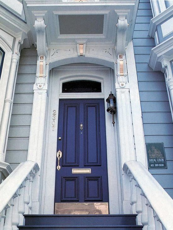 "11 Inviting Colors to Paint a Front Door: A Victorian home is a license to indulge in brilliant paint and trim choices. ""This style of architecture has so much detail that it takes a dark or bold color to draw your attention to the front door as a focal point,"" says Jackie Jordan, director of color marketing for Sherwin-Williams. This shade, Sherwin-Williams Indigo, harmonizes with the copper trim above and the brass hardware and kick plate below. From DIYnetwork.com"