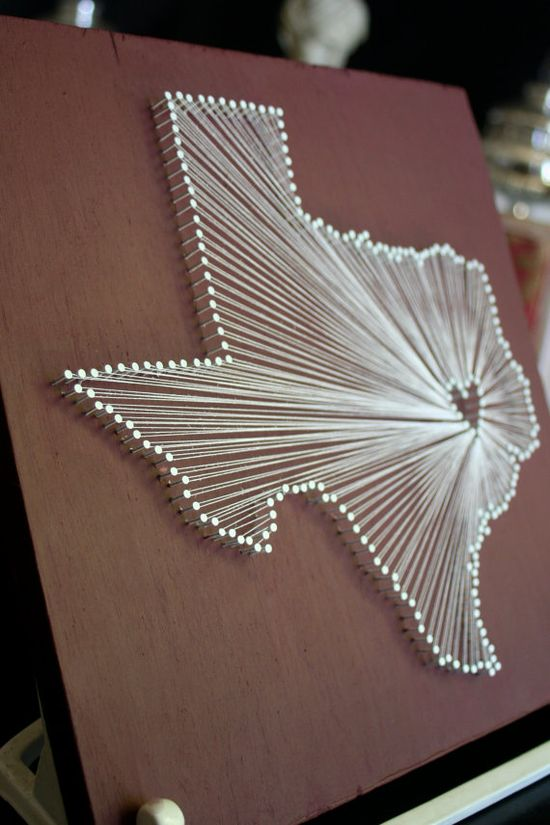 string art - cool idea. could do any shape using nails and strings.