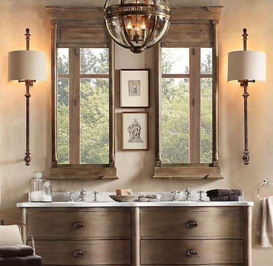 Round pendant light above double vanity, distressed wood mirrors
