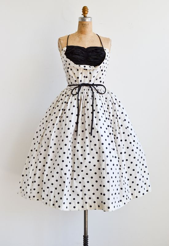 vintage 1950s bombshell dress polka dots