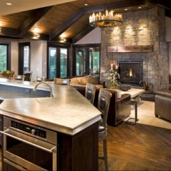 Dream kitchen!  This is what I want!  A big bar with an open view to the living area.