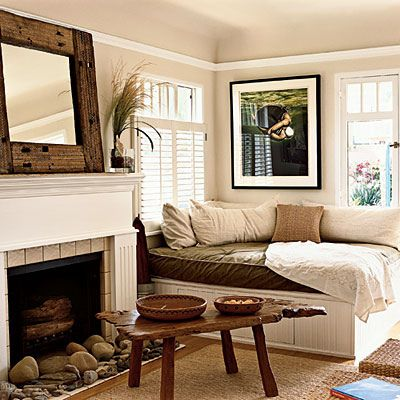 Love the daybed (with storage underneath); great idea for a fireplace....add a rock collection #bedroom #nature #collections #fireplace