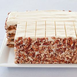 Carrot Layer Cake Recipe by americastestkitchen: Moist with a delicate spice and tangy cream cheese frosting. #Cake #Carrot