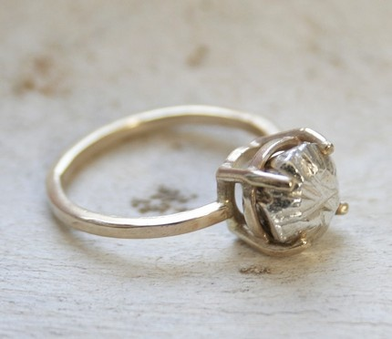 gorgeous ring with a piece of silver roughly carved into a beautiful diamond shape...