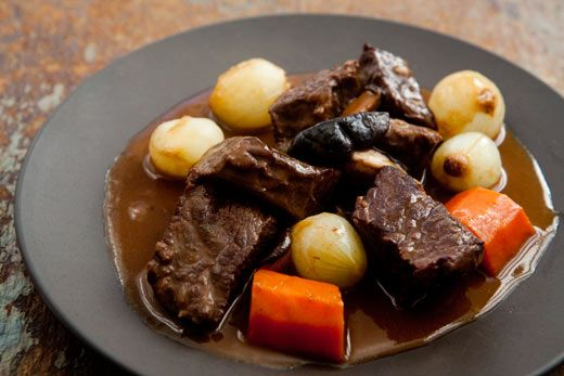 Luxurious beef bourguignon, or beef Burgundy, with beef chuck, carrots, pearl onions, mushrooms, and coated with a deeply flavored, silky sauce.