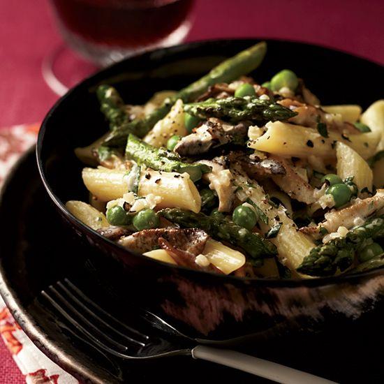 Penne with Asparagus, Peas, Mushrooms and Cream // More Penne Recipes: www.foodandwine.c... #foodandwine