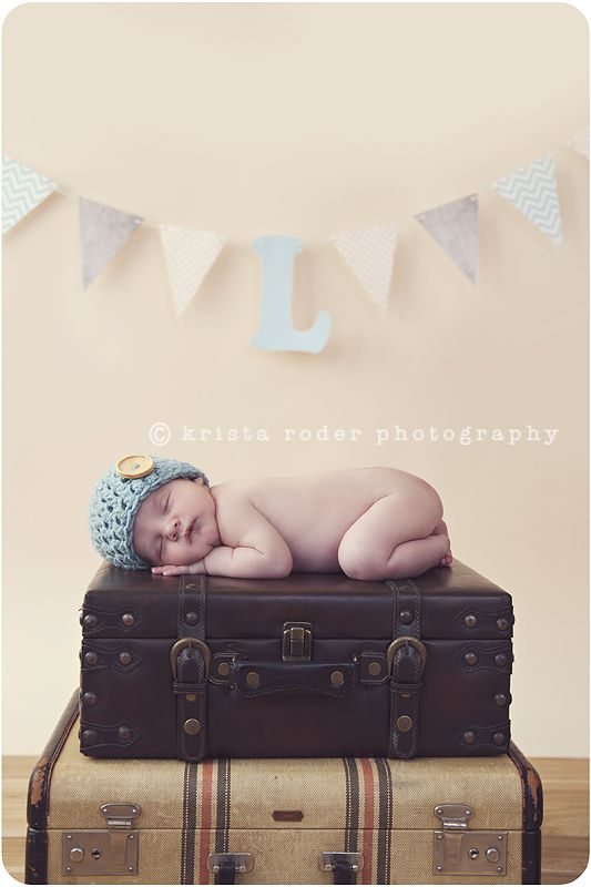 10 day old newborn boy on vintage suitcases