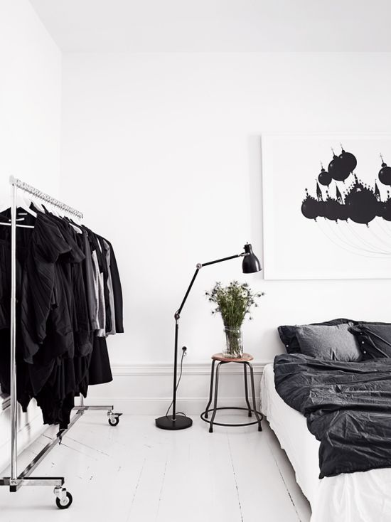black and white bedroom decor / white floor / gray sheets and comforter