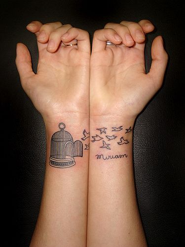 I'm in love with bird cage tattoos.