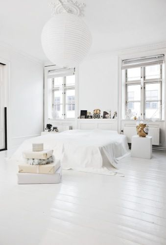 Crisp, and white bed room!