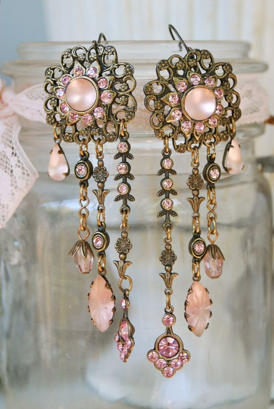 Could make these easily.  Old pair of earrings with open filigree work around the stones, then add broken pieces on wire or links to dangle. My girl friends would like love these. I've got to get busy.