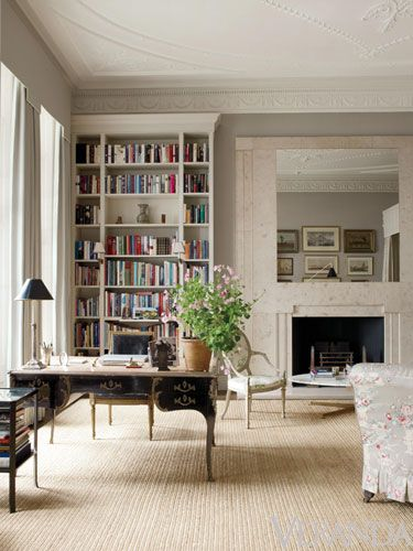 An elegant black lacquer desk in a neutral bedroom by Veere Grenney