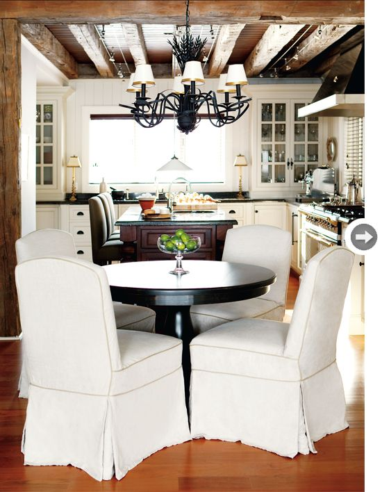 really like the exposed beams in this kitchen/dining combo. nice and airy too.