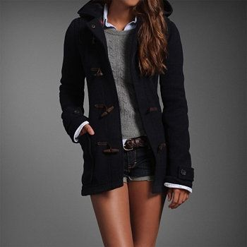 Navy jacket and gray sweater