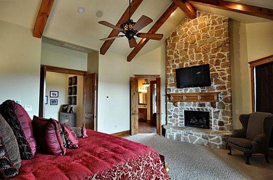 Love the wood beamed ceilings in this bedroom