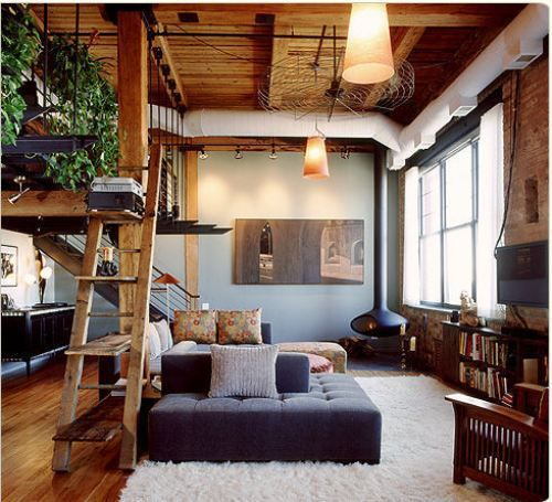 Love everything about this room layout. Furniture may be a bit too contemporary but wood floors, wood ceilings, industrial staircase. love.