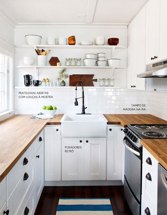 The traditional white kitchen with charming wooden details and wonderful open shelving.