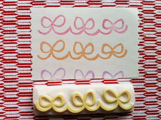 ribbon hand carved rubber stamp. handmade rubber stamp. for cards. for tags.. $13,00, via Etsy.