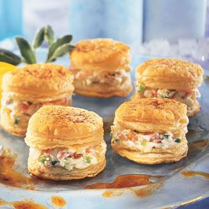 Here's some tasty appetizers sure to impress your guests. The crabmeat-cream cheese filling is flavored with a bit of horseradish...sliced green onions and almonds add both crunch and color.