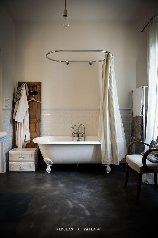 white bathroom with black floor