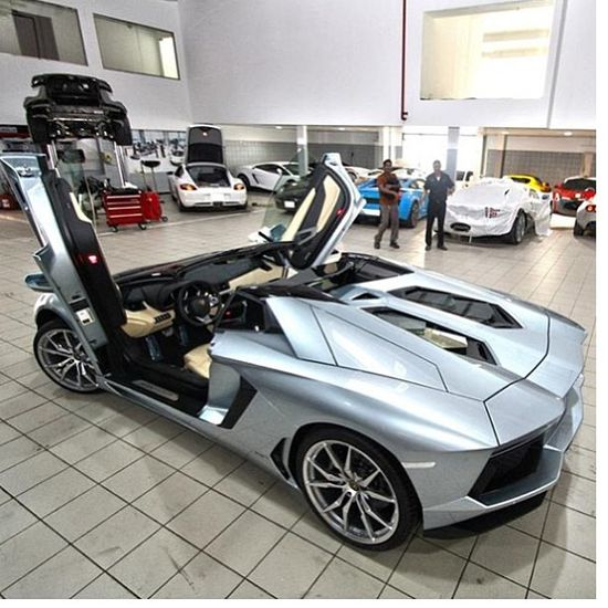 Love how the doors still open vertically on the Lamborghini Aventador Roadster
