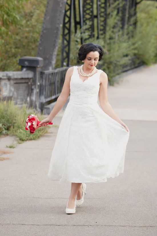 Tea length lace wedding dress with a netted veil