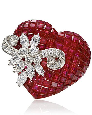 Harry Winston ruby brooch with diamond blossoms.  132 rubies (almost 55 carats) and diamonds ( > 4 carats). Part of a collection of one-off brooches inspired by sailor tattoos of the 1920s to 1950s.