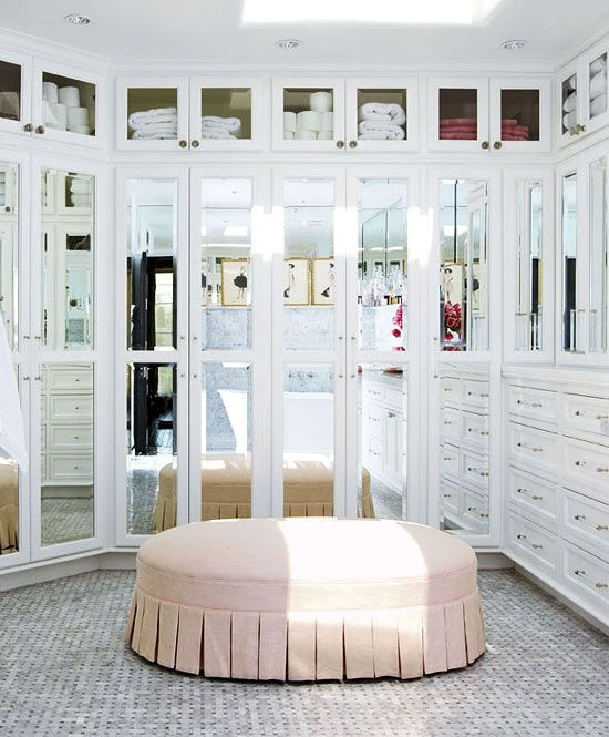 Mirrored doors and pleated ottoman