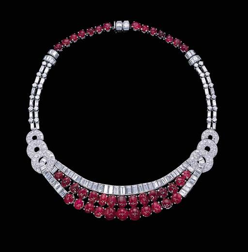 A CABOCHON RUBY AND DIAMOND NECKLACE   The front section designed as two cabochon ruby swags with baguette-cut diamond trim and three pavé-set diamond graduated scrolled shoulders to the cabochon ruby, circular and baguette-cut diamond twin-line backchain, circa 1933, 36.0 cm.