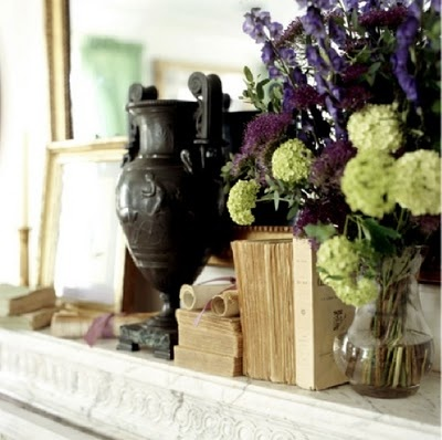 love pretty clutter on a mantle