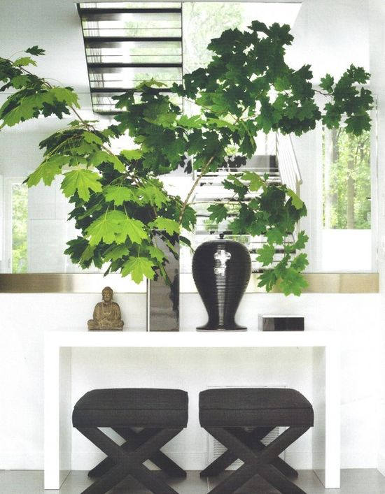 black and white interiors, white parsons table, green leaves in black vase